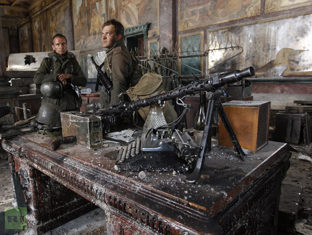 """Actors from a new Russian film """"Stalingrad"""" wait on a set  built near the village of Sapernoe outside St.Petersburg"""